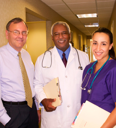 A group of healthcare providers stand together