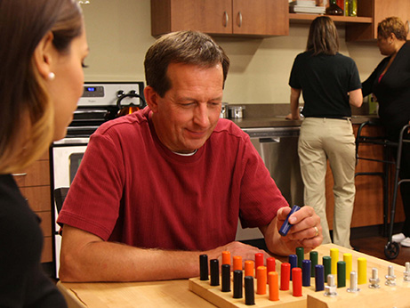 A man plays a game for occupational therapy
