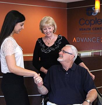 a senior rehabilitation patient meets with a caregiver